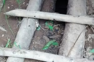 The Water Project: Ulagai Community, Aduda Spring -  Latrine Floor