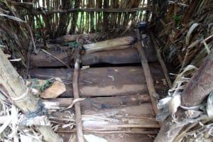 The Water Project: Emwanya Community, Josam Kutsuru Spring -  Dangerous Latrine Floor