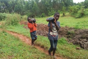 The Water Project: Kakubudu Community, Fred Lagueni Spring -  Helping The Artisans