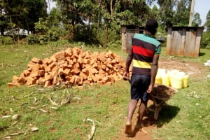 The Water Project: El'longo Secondary School -  Transporting Materials