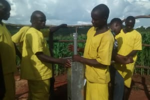The Water Project: Maiha-Kayanja Community -  Prisoners Helping With Pump Installation