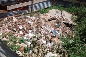 The Water Project: JM Rembe Primary School -  Collapsed Latrine Turned Into Garbage Site