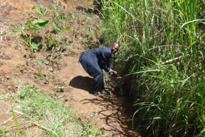 The Water Project: Elukuto Community, Isa Spring -  Current Water Source