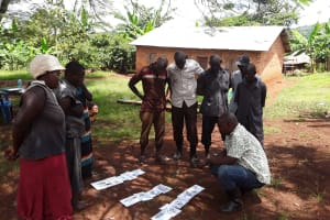 The Water Project: Maiha-Kayanja Community -  Stephen Explaining Contamination Routes