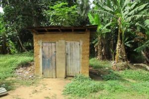 The Water Project: Tholmosor Community, Alpha Dabola Road -  Latrine