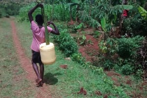 The Water Project: Ivulugulu Community, Ishangwela Spring -  Carrying Water
