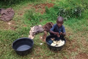 The Water Project: Bumavi Community, Esther Spring -  Amos Washing His Clothes By Spring