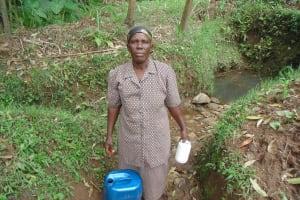 The Water Project: Shiru Community, Sammy Alumola Spring -  Mrs Alumola