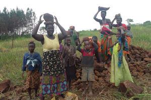 The Water Project: Ejinga-Ayikoru Community -  People Bringing Stones To Help The Artisan