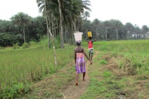 The Water Project: Sanya Community -  Carrying Water