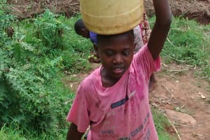 The Water Project: Shiru Community, Sammy Alumola Spring -  Carrying Water And Some Guavas