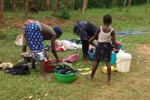 The Water Project: Ulagai Community, Rose Obare Spring -  Doing Laundry By The Spring