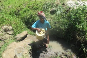 The Water Project: Futsi Fuvili Community, Simeon Shimaka Spring -  Carrying Water