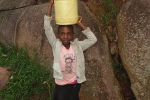 The Water Project: Chandolo Community, Joseph Ingara Spring -  Alice Carrying Water