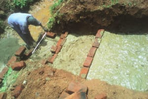 The Water Project: Mudete Community, Wadimbu Spring -  Spring Construction