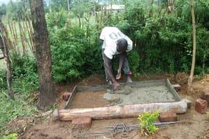 The Water Project: Luyeshe Community, Simwa Spring -  Sanitation Platform Construction