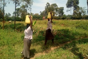The Water Project: Ikonyero Community, Jesse Spring -  Carrying Water