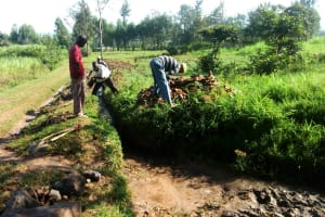 The Water Project: Luyeshe Community, Simwa Spring -  Digging Drainage