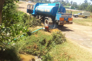 The Water Project: Shibale Secondary School -  Boozer Getting Water