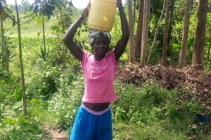The Water Project: Musango Community, M'muse Spring -  Carrying Water