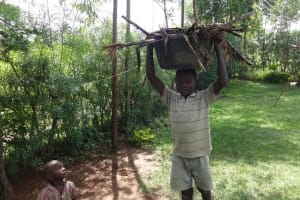 The Water Project: Elukuto Community, Isa Spring -  Ibrahim Cleaning Up His Compound