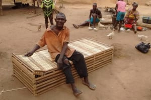 The Water Project: Sanya Community -  Furniture Maker Proud Of His Bench