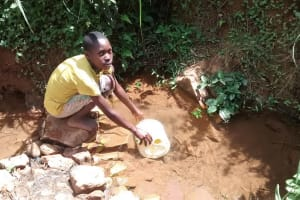 The Water Project: Jivovoli Community, Wamunala Spring -  Fetching Water