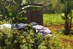 The Water Project: Jivovoli Community, Gideon Asonga Spring -  Latrine And Clothes Drying