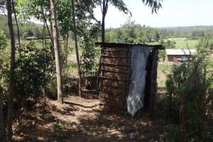 The Water Project: Ingavira Community, Laban Mwanzo Spring -  Latrine