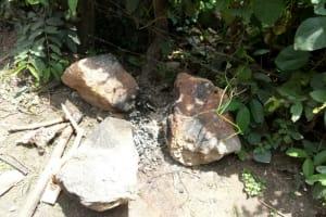 The Water Project: Jivovoli Community, Wamunala Spring -  Fireplace Outside