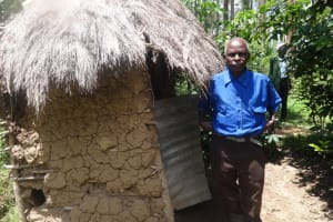 The Water Project: Masera Community, Ernest Mumbo Spring -  Village Elder Stands By His Latrine