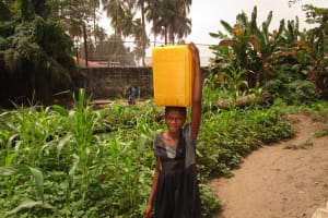 The Water Project: Tulun Community, 10 Tulon Road -  Carrying Water