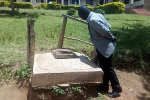 The Water Project: Bishop Makarios Secondary School -  Principal Showing Us The Open Well