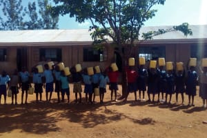The Water Project: Kenneth Marende Primary School -  Students With Their Water Containers