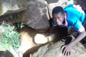 The Water Project: Kapsotik Primary School -  Fetching Water