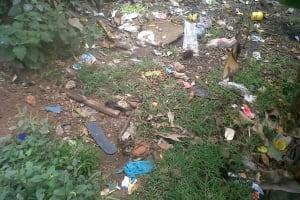 The Water Project: Jivovoli Community, Wamunala Spring -  Garbage Behind A Home
