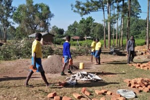 The Water Project: Munyanda Primary School -  Students Carrying Bricks To The Construction Site
