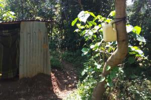 The Water Project: Luvambo Community, Tindi Spring -  Latrine And Improvised Hand Washing Station
