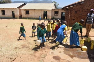 The Water Project: Kithumba Primary School -  Students Accessing Water Storage