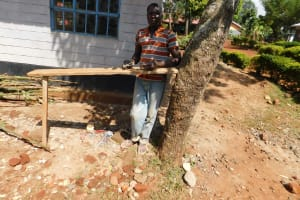 The Water Project: Womulalu Primary School -  Sanding A Latrine Door