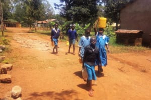 The Water Project: Eshilibo Primary School -  Students Bringing Water From Home
