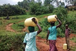 The Water Project: Jivovoli Community, Wamunala Spring -  Carrying Water