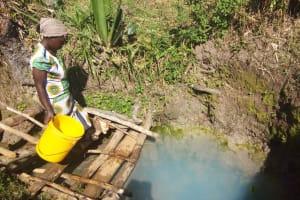 The Water Project: Matsakha Community, Mbakaya Spring -  Fasilia Hassan Fetching Water