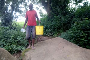 The Water Project: Muraka Community, Peter Itevete Spring -  Going To Fetch Water