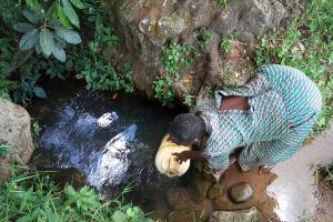 The Water Project: Muyundi Community, Baraza Spring -  Fetching Water
