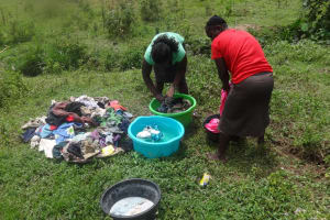 The Water Project: Masera Community, Ernest Mumbo Spring -  Women Doing Laundry By The Spring