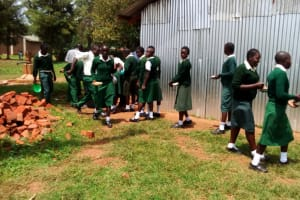 The Water Project: Injira Secondary School -  Students On Their Way To The Primary School To Rinse Lunch Dishes