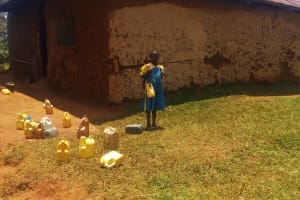 The Water Project: Eshilibo Primary School -  A Little Girl With Her Water Container