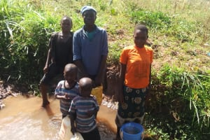 The Water Project: Burachu B Community, Shitende Spring -  Fetching Water