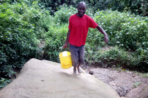The Water Project: Muraka Community, Peter Itevete Spring -  Carrying Water